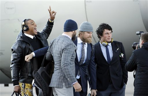 <div class='meta'><div class='origin-logo' data-origin='none'></div><span class='caption-text' data-credit='AP/David J. Phillip'>Carolina Panthers' Cam Newton jumps into a team photo after getting off the plane at San Jose at the Mineta San Jose International Airport on Sunday, Jan. 31, 2016.</span></div>