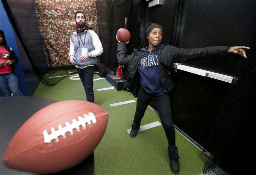 <div class='meta'><div class='origin-logo' data-origin='none'></div><span class='caption-text' data-credit='AP/Chevron'>Student from Lavonya DeJean Middle School in Richmond, Calif., throws a football in the pass analysis activity in the Chevron STEM Zone on Tuesday, Feb. 2, 2016.</span></div>