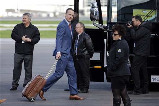 <div class='meta'><div class='origin-logo' data-origin='none'></div><span class='caption-text' data-credit='AP/David J. Phillip'>Denver Broncos' Peyton Manning arrives in San Jose on Sunday, Jan. 31, 2016.</span></div>