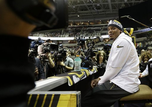 <div class='meta'><div class='origin-logo' data-origin='none'></div><span class='caption-text' data-credit='AP/David J. Phillip'>Carolina Panthers' Cam Newton answers a question during Opening Night for the NFL Super Bowl 50 football game Monday, Feb. 1, 2016, in San Jose, Calif.</span></div>