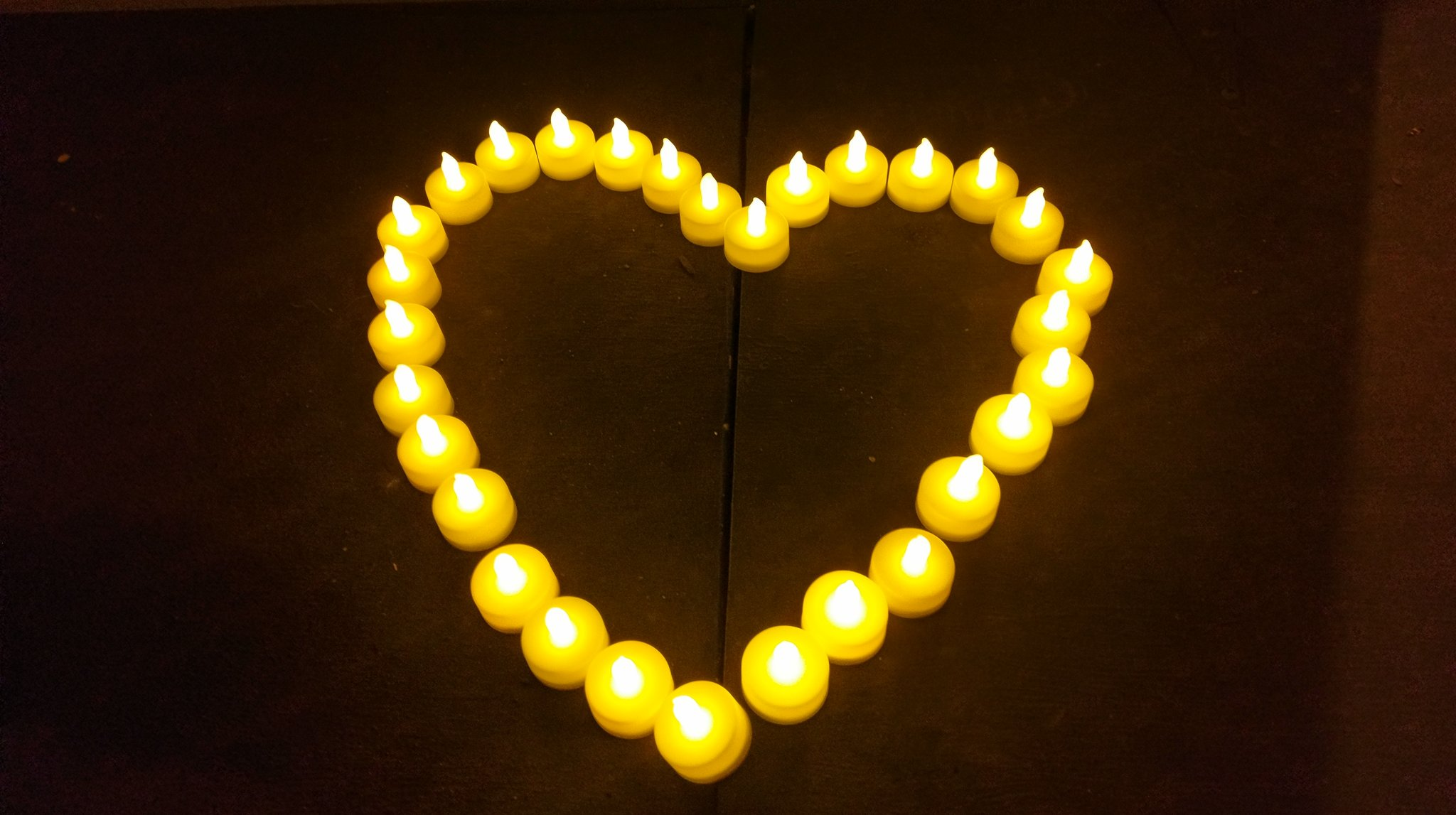 "<div class=""meta image-caption""><div class=""origin-logo origin-image none""><span>none</span></div><span class=""caption-text"">Candles in a heart shape appear at a vigil held for the victims of the Ghost Ship Fire at Lake Merritt in Oakland on Dec. 5, 2016. (Kate Eby)</span></div>"