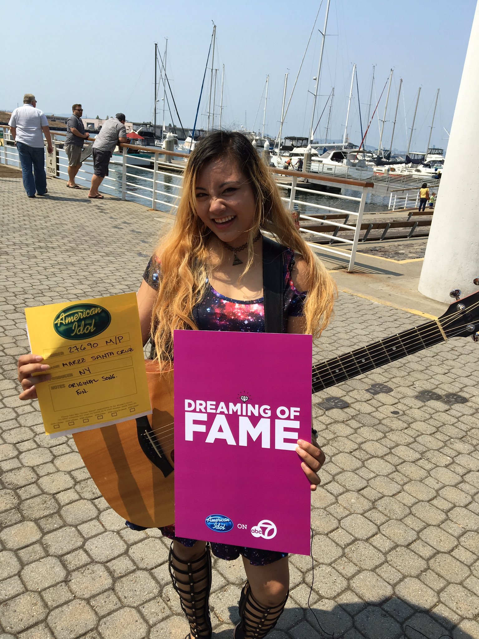 <div class='meta'><div class='origin-logo' data-origin='none'></div><span class='caption-text' data-credit='KGO-TV'>An &#34;American Idol&#34; hopeful holds up her golden ticket after passing a round of auditions in Oakland, Calif. on Sunday, Aug. 20, 2017.</span></div>