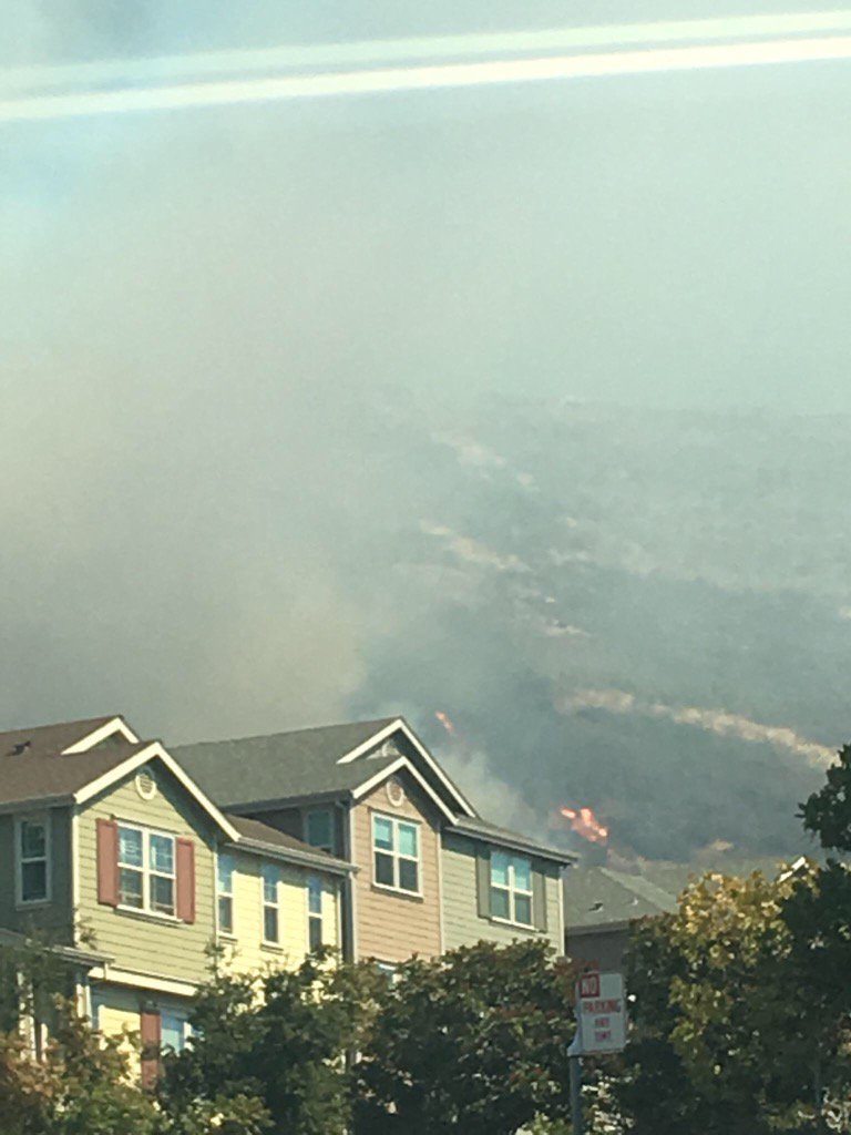 <div class='meta'><div class='origin-logo' data-origin='none'></div><span class='caption-text' data-credit='Marlon Harrison'>A fire in the Oakland Hills is seen from a nearby neighborhood on Tuesday, Sept. 26, 2017.</span></div>