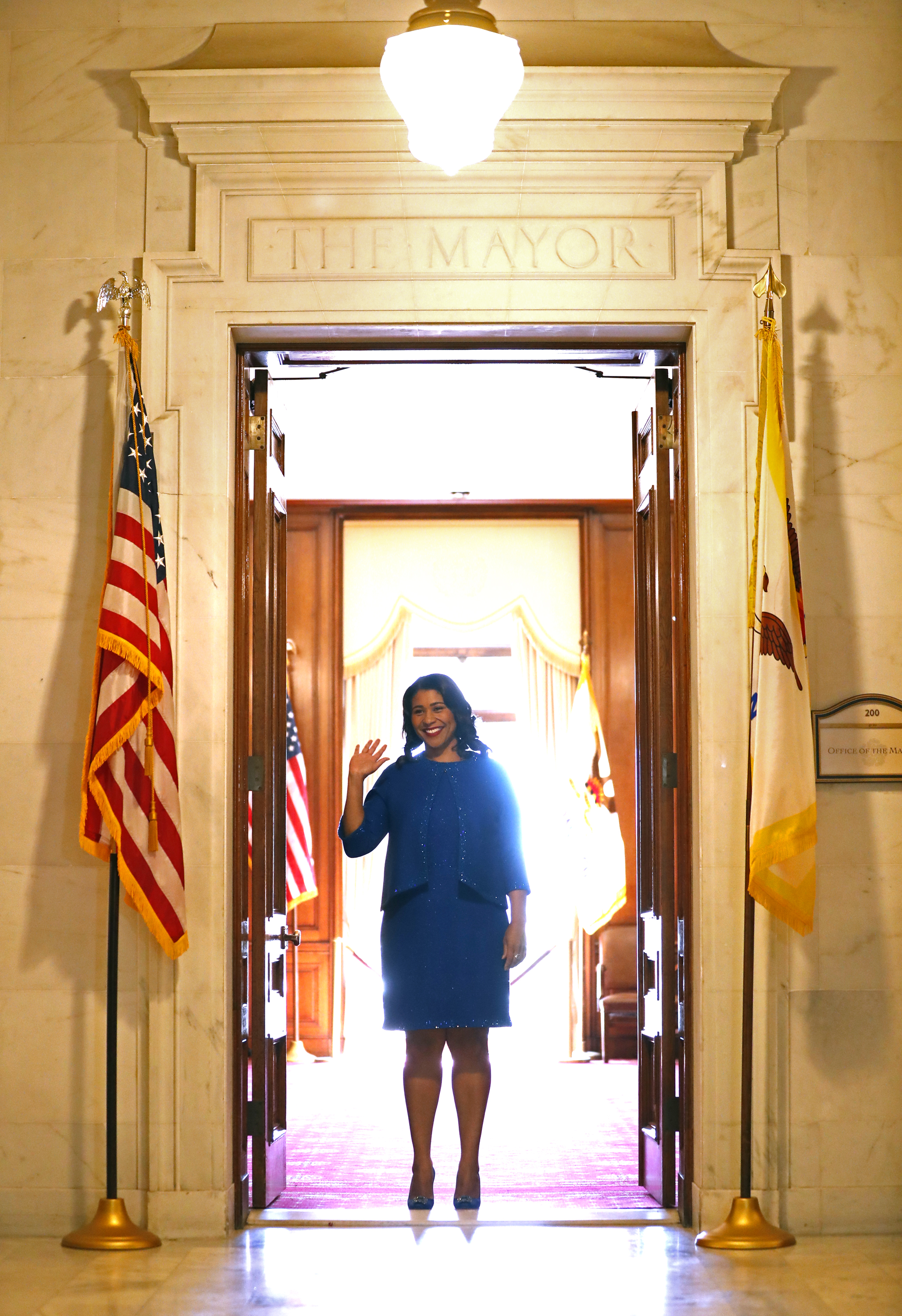 <div class='meta'><div class='origin-logo' data-origin='none'></div><span class='caption-text' data-credit='The Chronicle'>San Francisco Mayor London Breed waves at a well-wisher as she leaves the Mayor's Office before her inauguration at City Hall in San Francisco, Calif. on Wednesday, July 11, 2018.</span></div>
