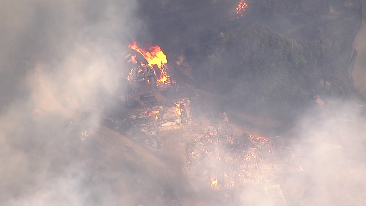 <div class='meta'><div class='origin-logo' data-origin='none'></div><span class='caption-text' data-credit='Photo submitted to KGO-TV by @Hendo1988/Twitter'>A fast-growing brush fire burns on Loma Prieta in the Santa Cruz Mountains on Monday, September 26, 2016.</span></div>