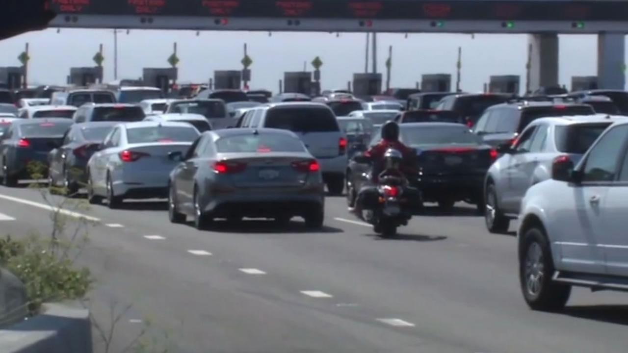 This image shows motorcycle lane splitting by the Bay Bridge.