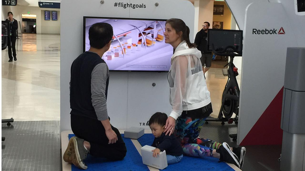 Two air travelers along with an infant test yoga mats at the A3 new concept modular workout space at Mineta San Jose International Airport. Monday, April 24, 2017KGO-TV