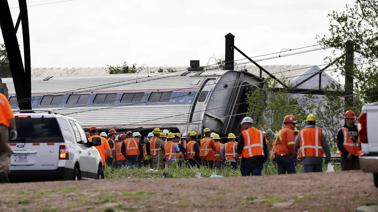 Emergency personnel gather near the scene of a deadly train derailment, Wednesday, May 13, 2015, in Philadelphia. (AP Photo/Mel Evans)