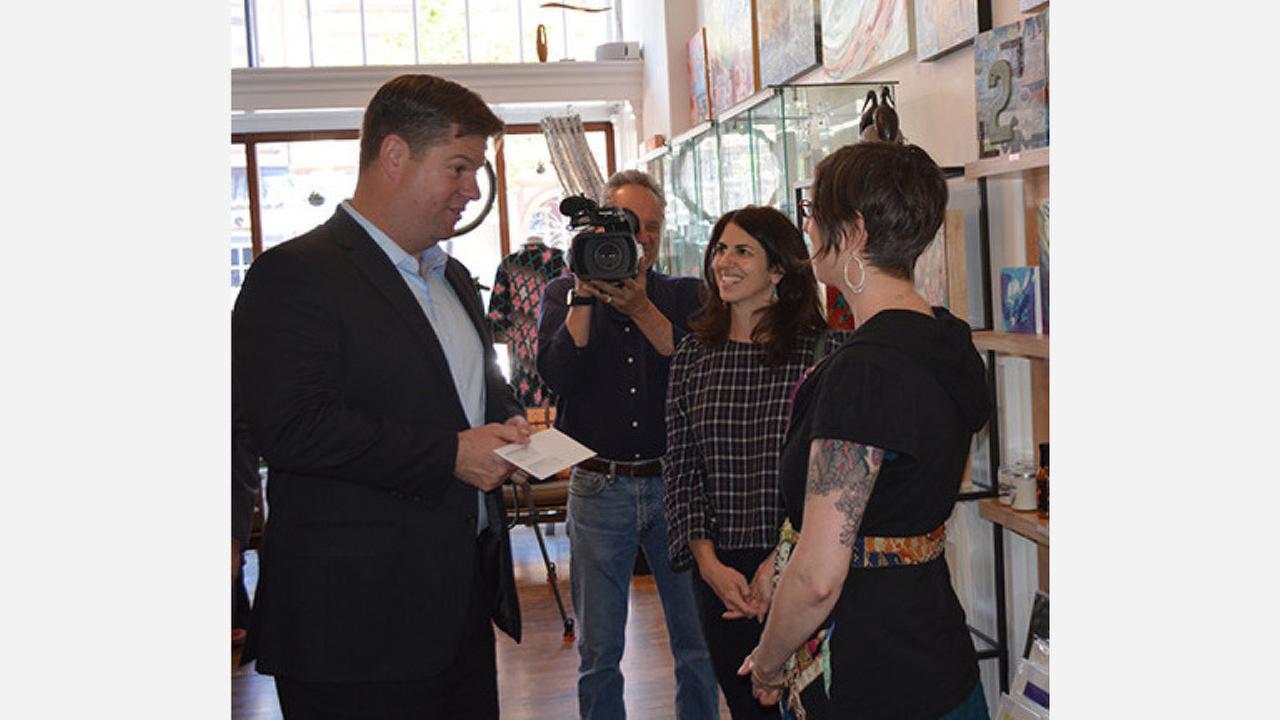 Mayor Mark Farrell presenting check to Eden Stein. Photo: MEDA/Facebook