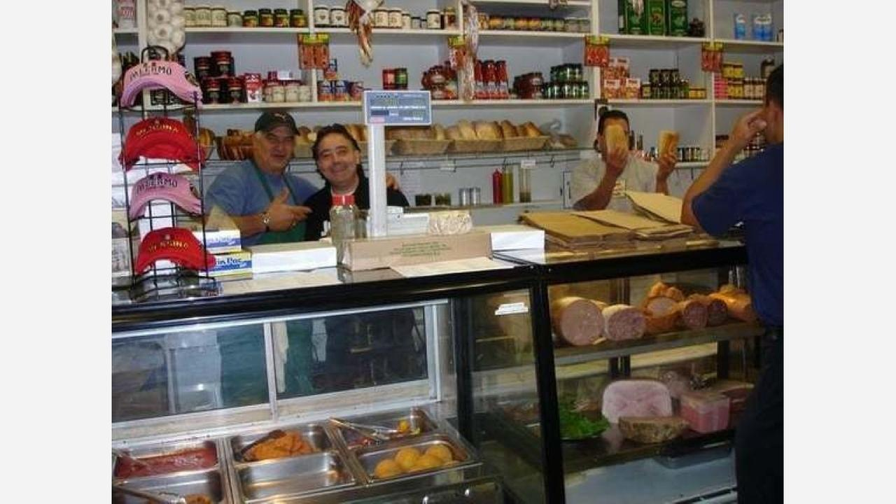 Behind the counter at the former Palermo Delicatessen. | Photo: lee b./Yelp