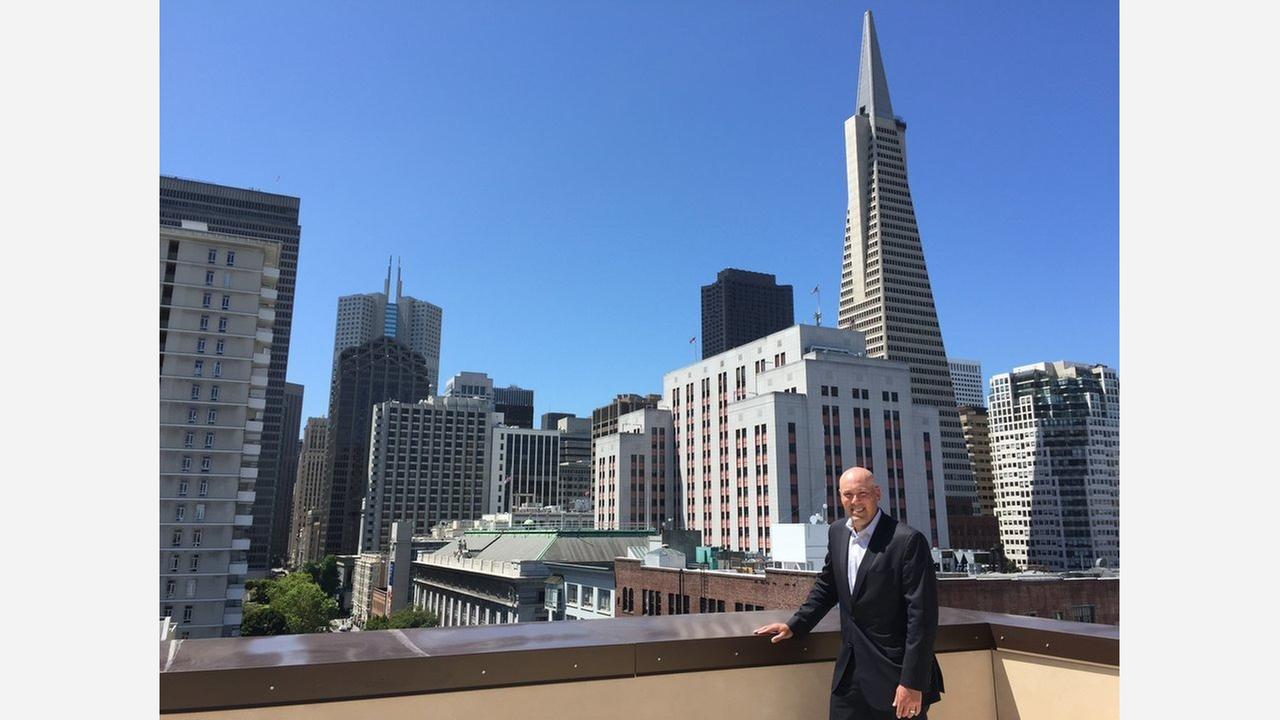 Steve Buster of Grosvenor Americas shows off a view from a penthouse at 288 Pacific. Photo: Geri Koeppel/Hoodline