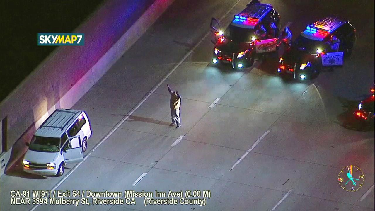A chase suspect surrenders to officers on the westbound 91 Freeway in Riverside on Friday, April 7, 2017.