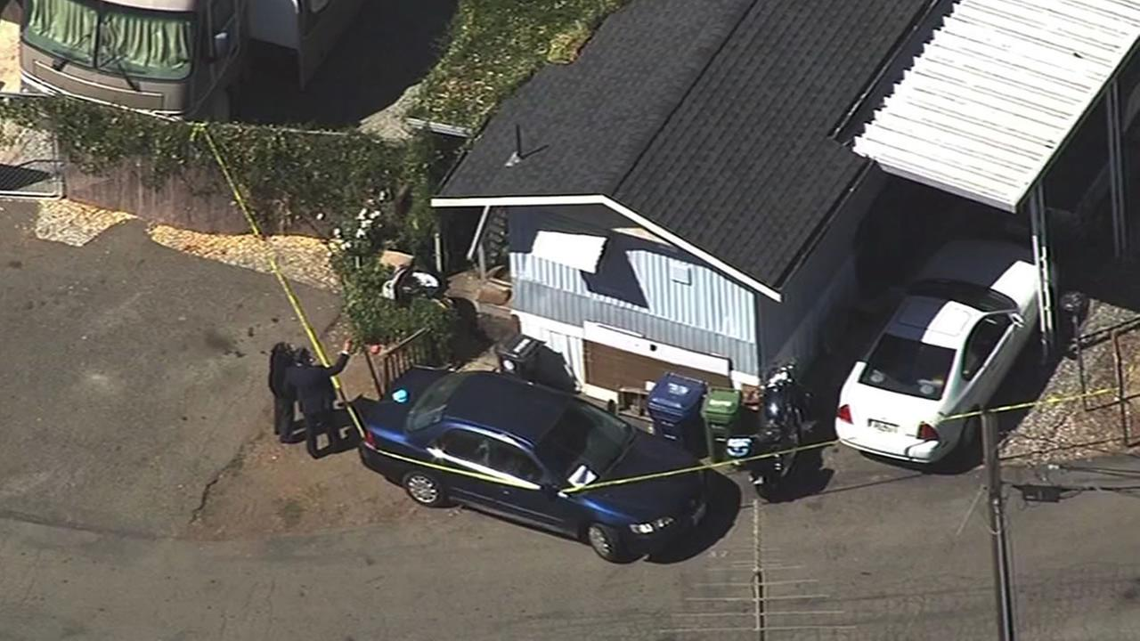 Police investigate a double homicide at a mobile home in Castro Valley, Calif. on Monday, September 28, 2015.