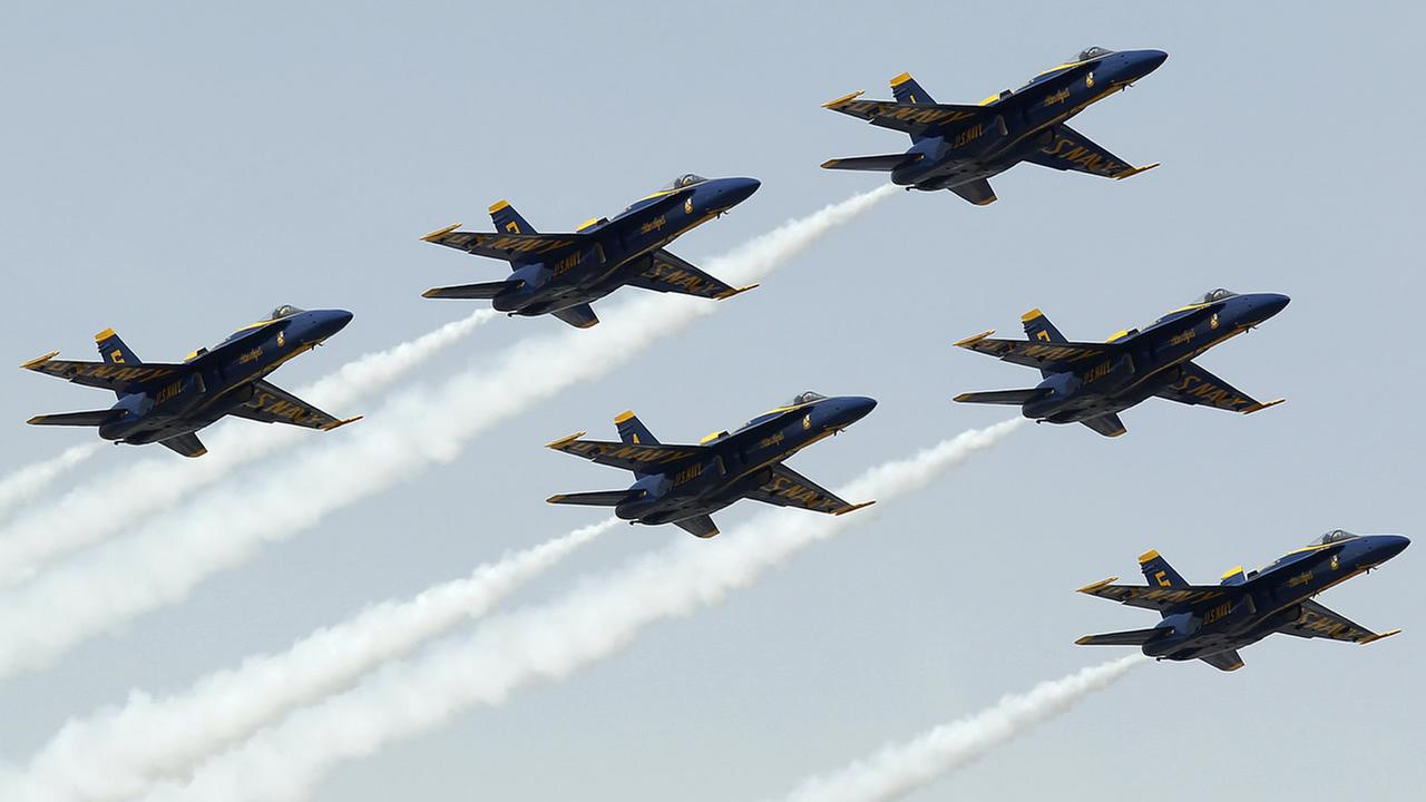 This March 23, 2014 file photo shows the U.S. Navys Blue Angels flying over during the national anthem before the NASCAR Sprint Series auto race in Fontana, Calif. (AP Photo)