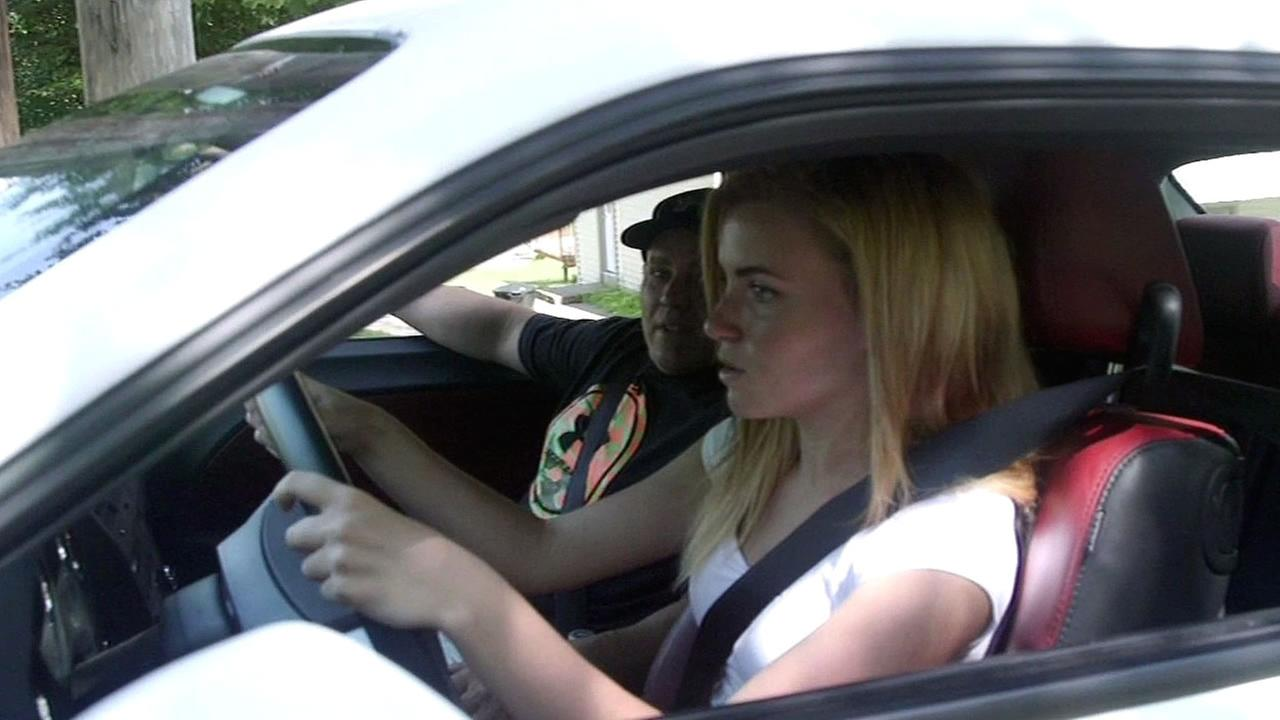 FILE - A teenager is seen driving a car in this undated image.