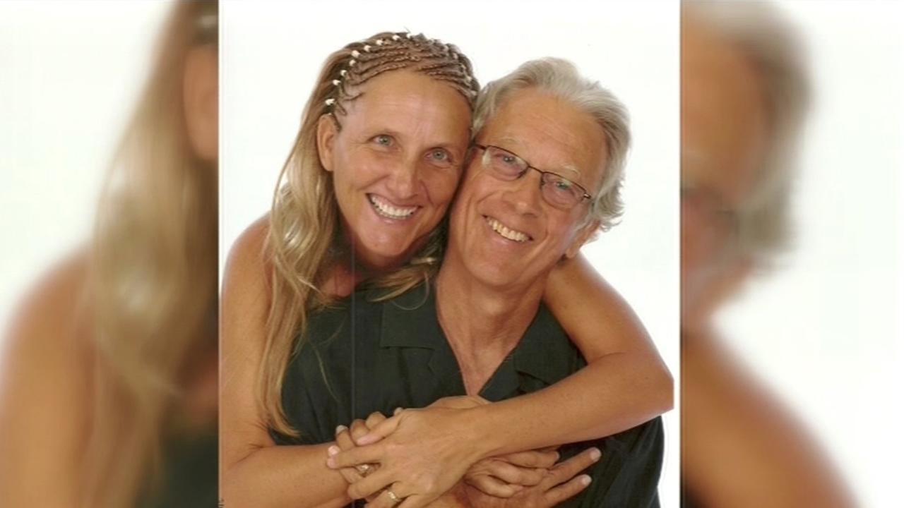 Steve Carter, a yoga teacher who was fatally shot on a trail near Fairfax, Calif., is seen smiling with his wife in this undated image.