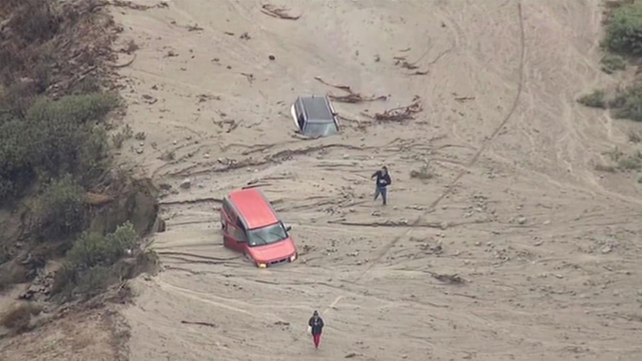 Severe flooding and thunderstorms in north Los Angeles County left cars stuck in a major mud flow Oct. 15, 2015.