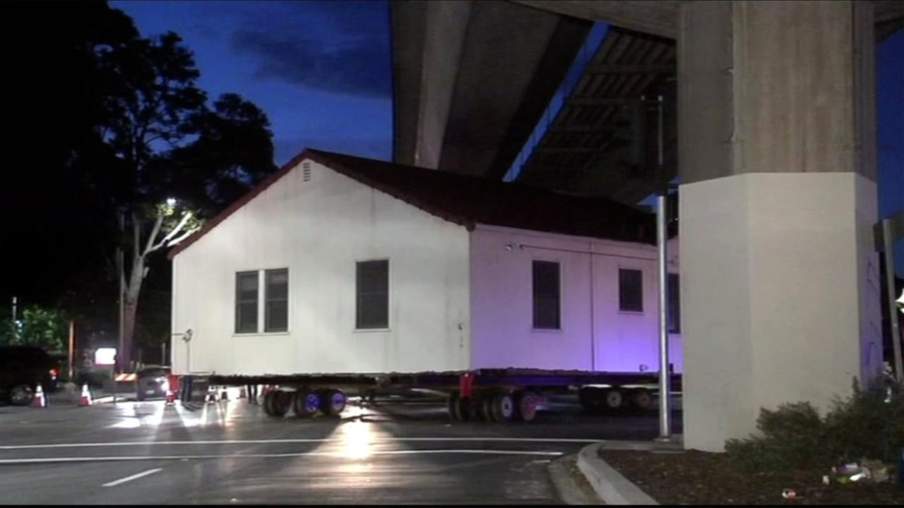 Crews moved an entire house on Sunday, October 18, 2015 to make room for a new outpatient center at the UCSF Benioff Childrens Hospital Oakland, Calif.