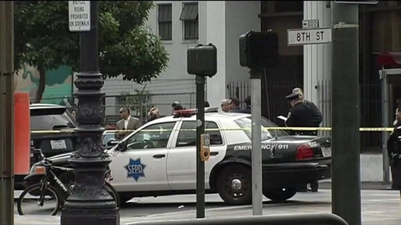 San Francisco police officers stand at the scene of an officer-involved shooting that left one man dead and two officers injured on Thursday, October 15, 2015.