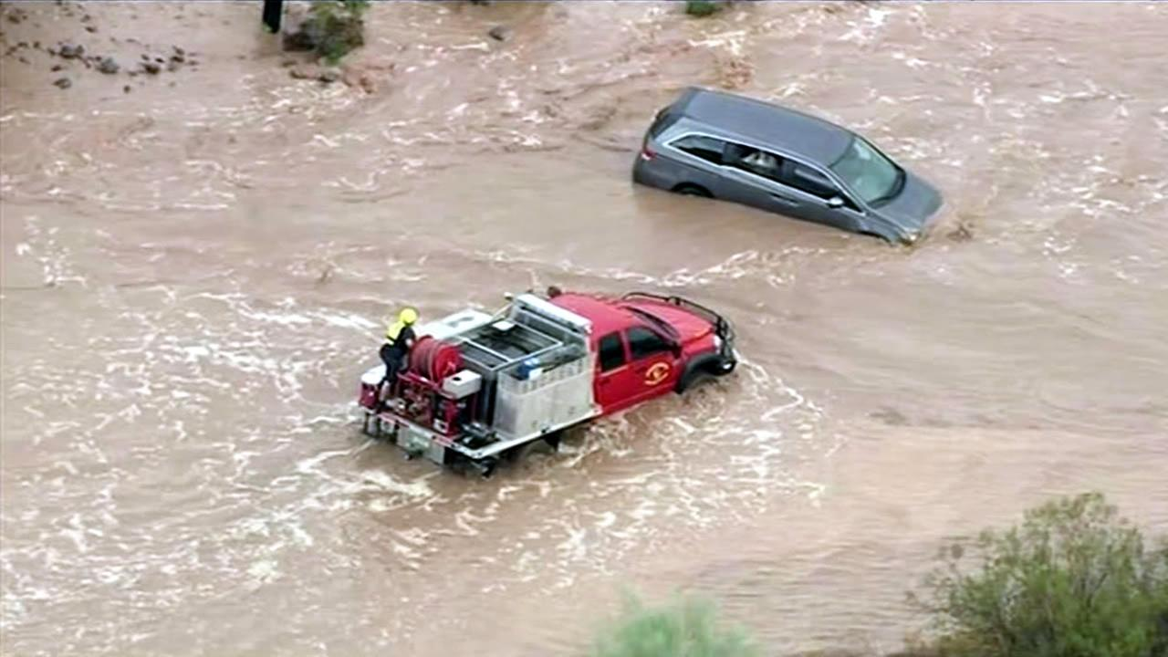 Crews rescued a woman who got stuck inside her mini-van during a severe storm that caused massive flooding in Arizona on Tuesday, October 20, 2015.