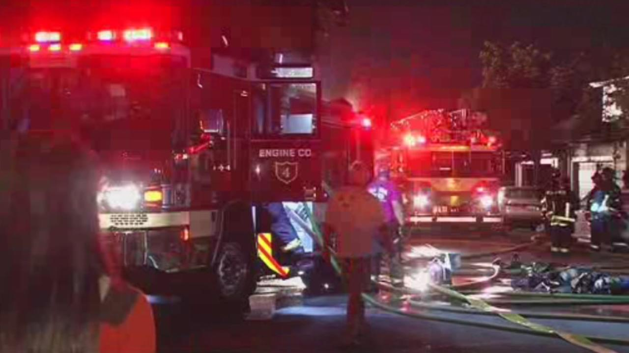 Alameda County officials are investigating the cause of a two-alarm fire that ripped through two homes on Sunday, October 18, 2015, in Alameda, Calif.
