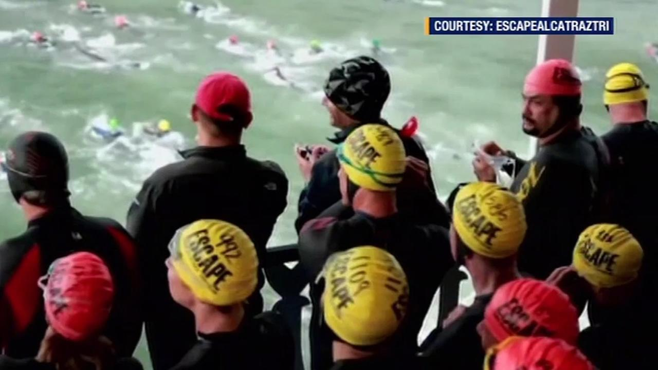 FILE - Swimmers take part in the Alcatraz Triathlon in San Francisco, Calif. in this undated image.