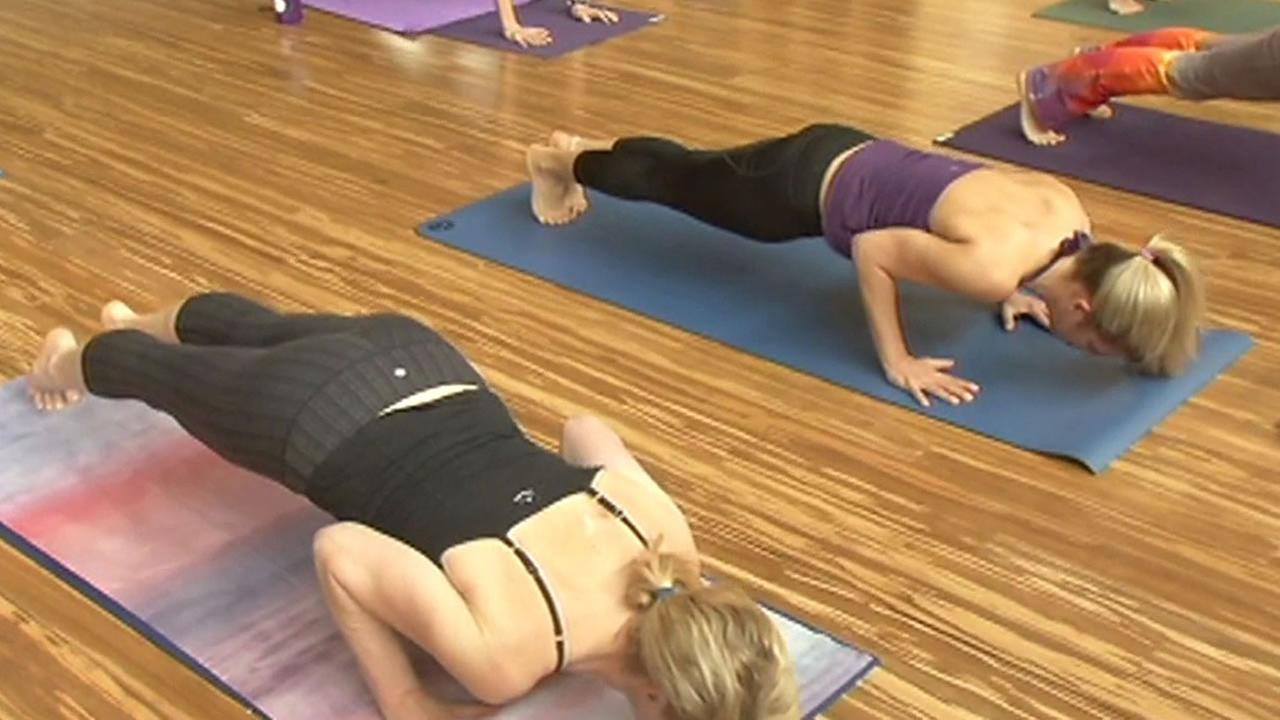 two women doing yoga at Hot Spot Yoga in Oakland