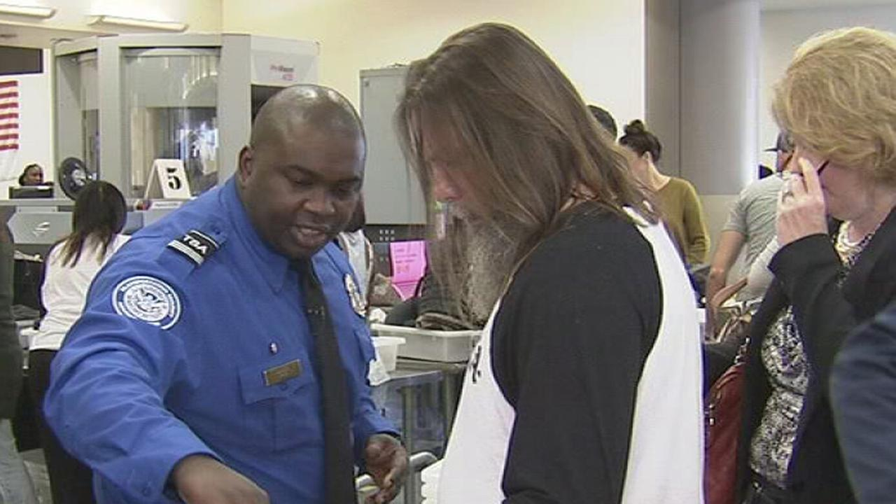 FILE - TSA hero at LAX