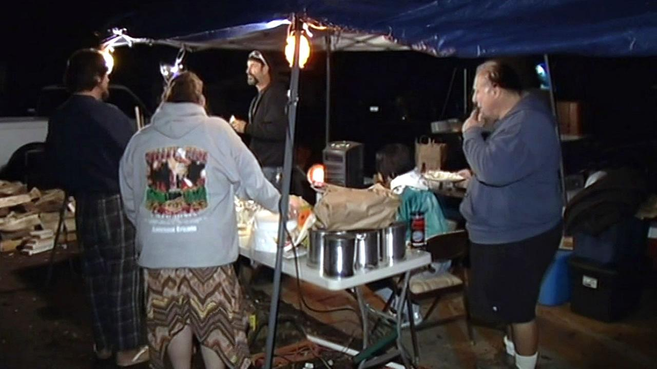 Valley Fire evacuees under a tent