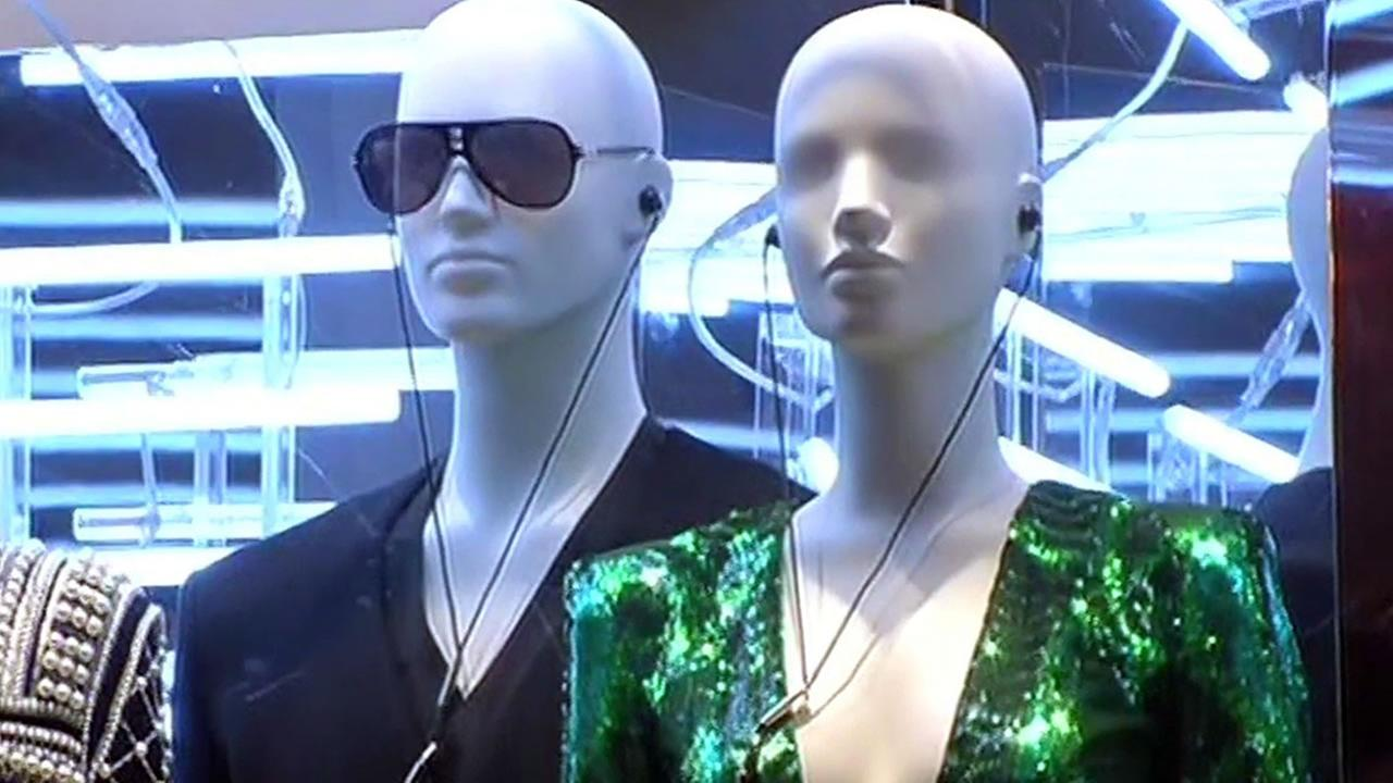 In this image, two mannequins wear clothes by designer Pierre Balmain at an H&M clothing store in San Francisco, Calif.