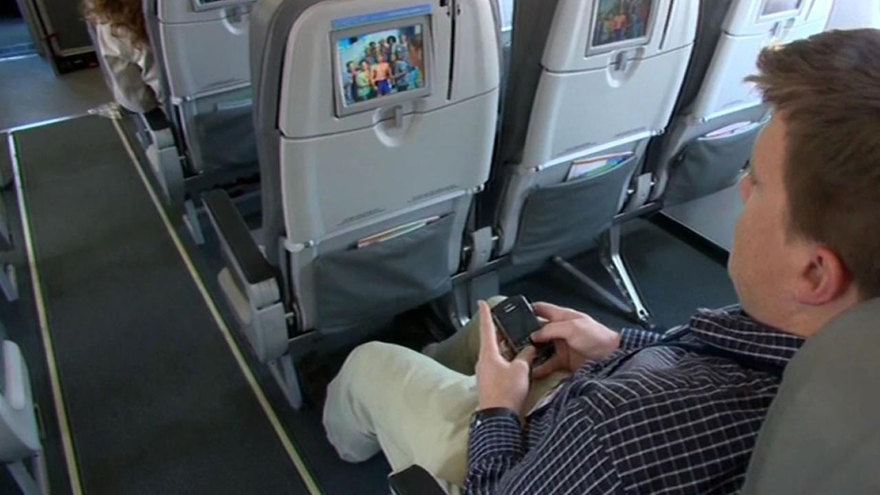 man sitting on airplane