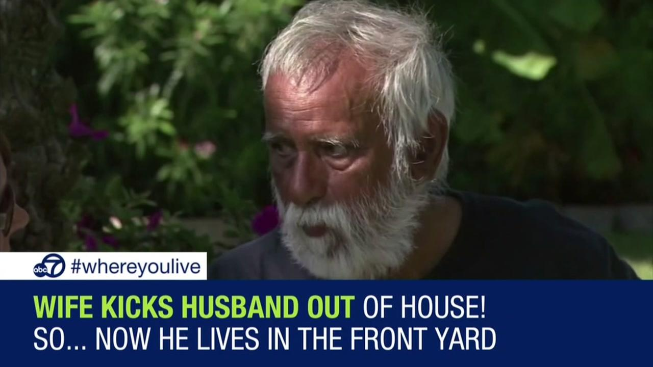 Man kicked out of house lives in front yard