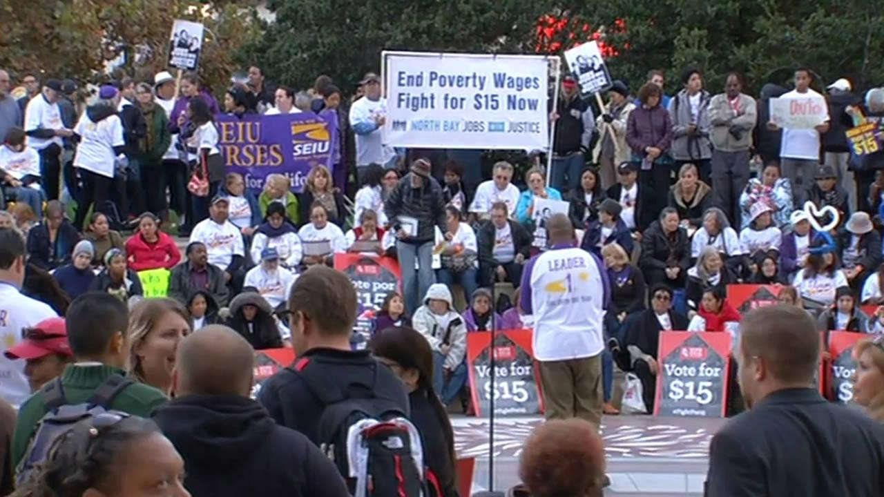 Bay Area workers in Oakland take part in a nationwide protest demanding a living wage on Tuesday, November 10, 2015.