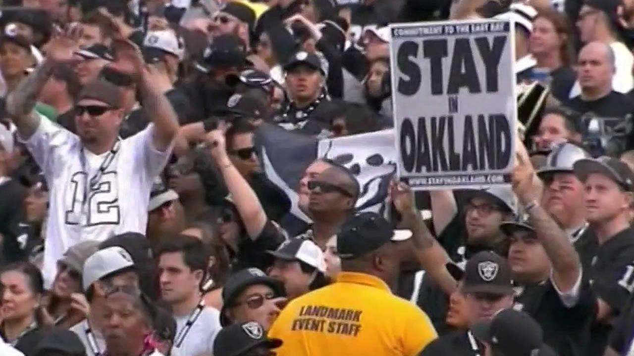 FILE - An Oakland Raiders fan holds up a sign during a game in this undated image.