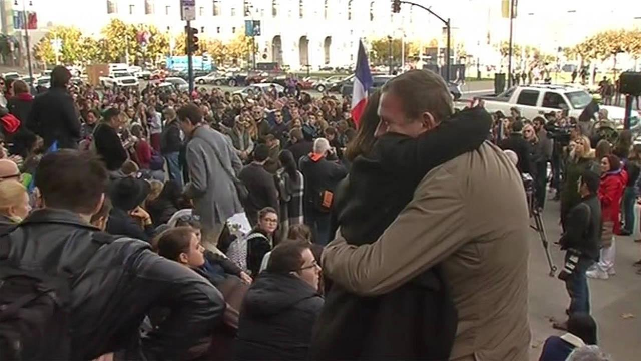 In this image, hundreds of people gather at San Francisco City Hall to remember those killed in the Paris attacks on Sunday, November 15, 2015.