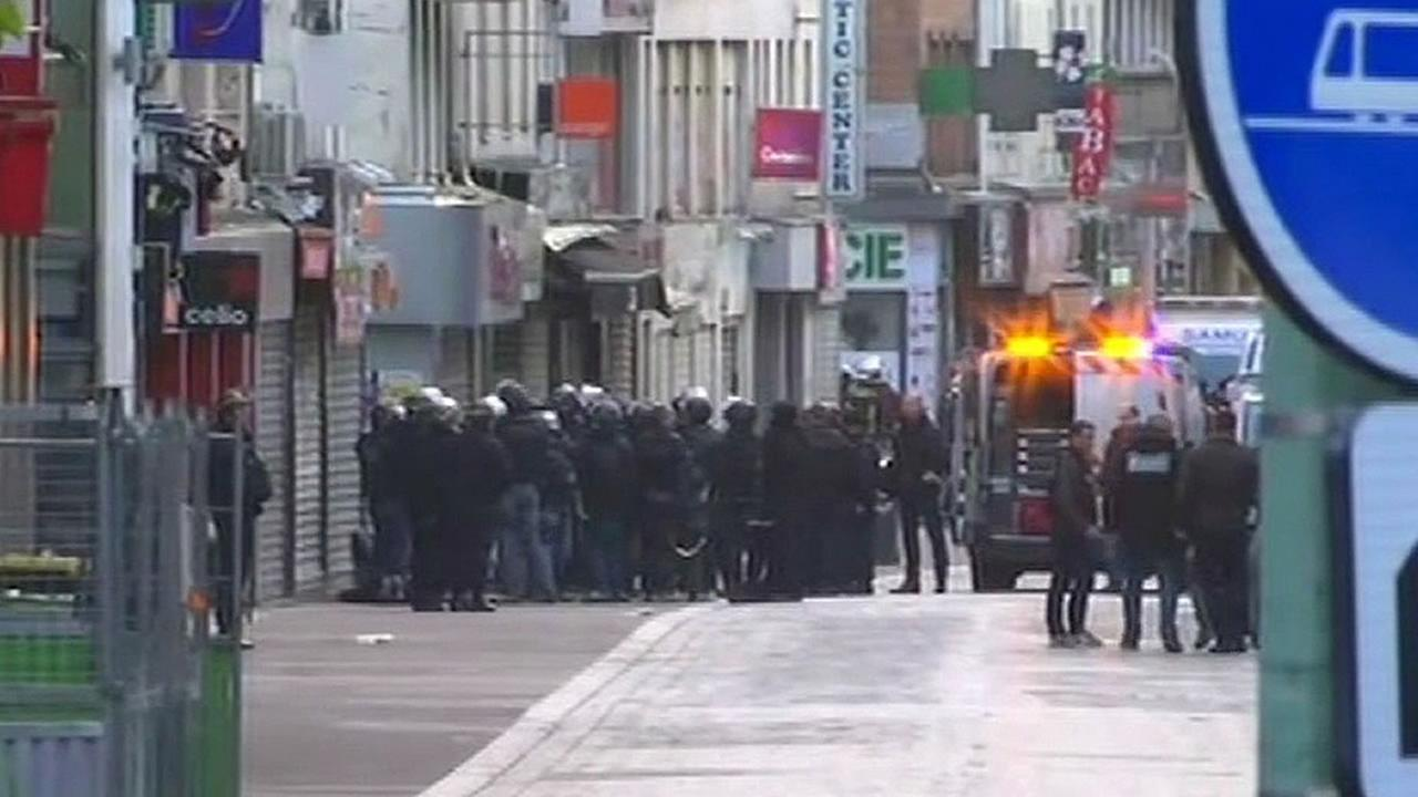 French police gather in Paris suburb Saint Denis November 18, 2015 in an effort to capture the suspected mastermind in Fridays Paris attacks.