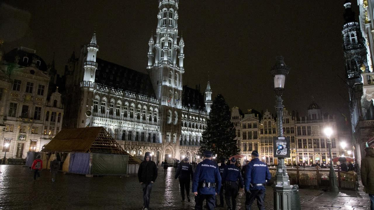 Police patrol in the Grand Place in the center of Brussels on Saturday, Nov. 21, 2015.