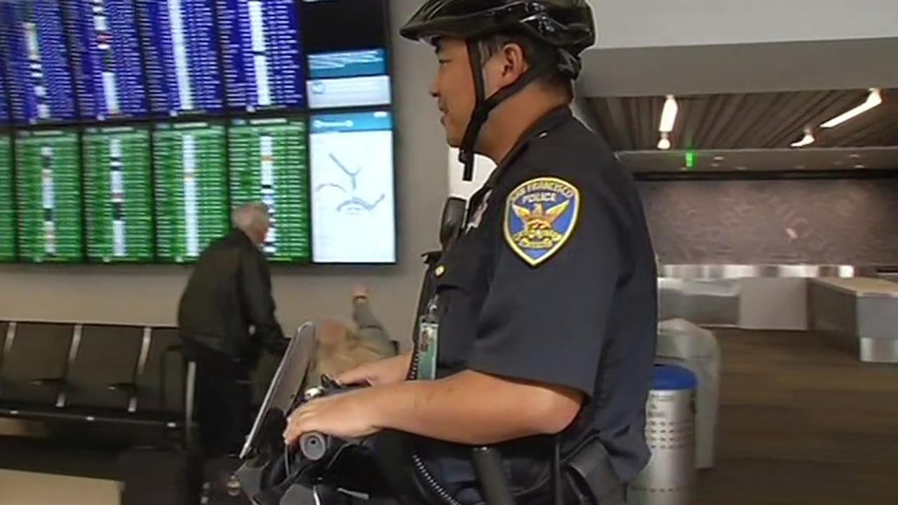 A security officer patrols San Francisco International Airport on Tuesday, November 24, 2015.