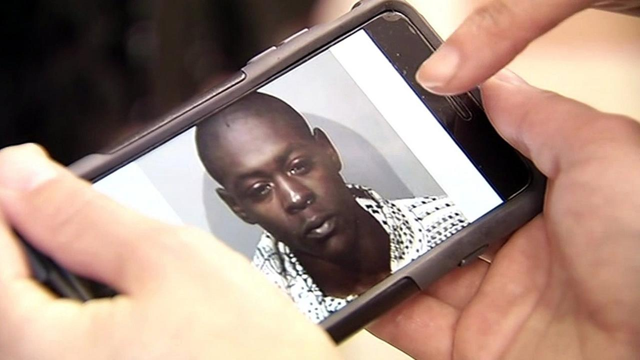 In this image, Marquise Holloway is seen on a cellphone screen.