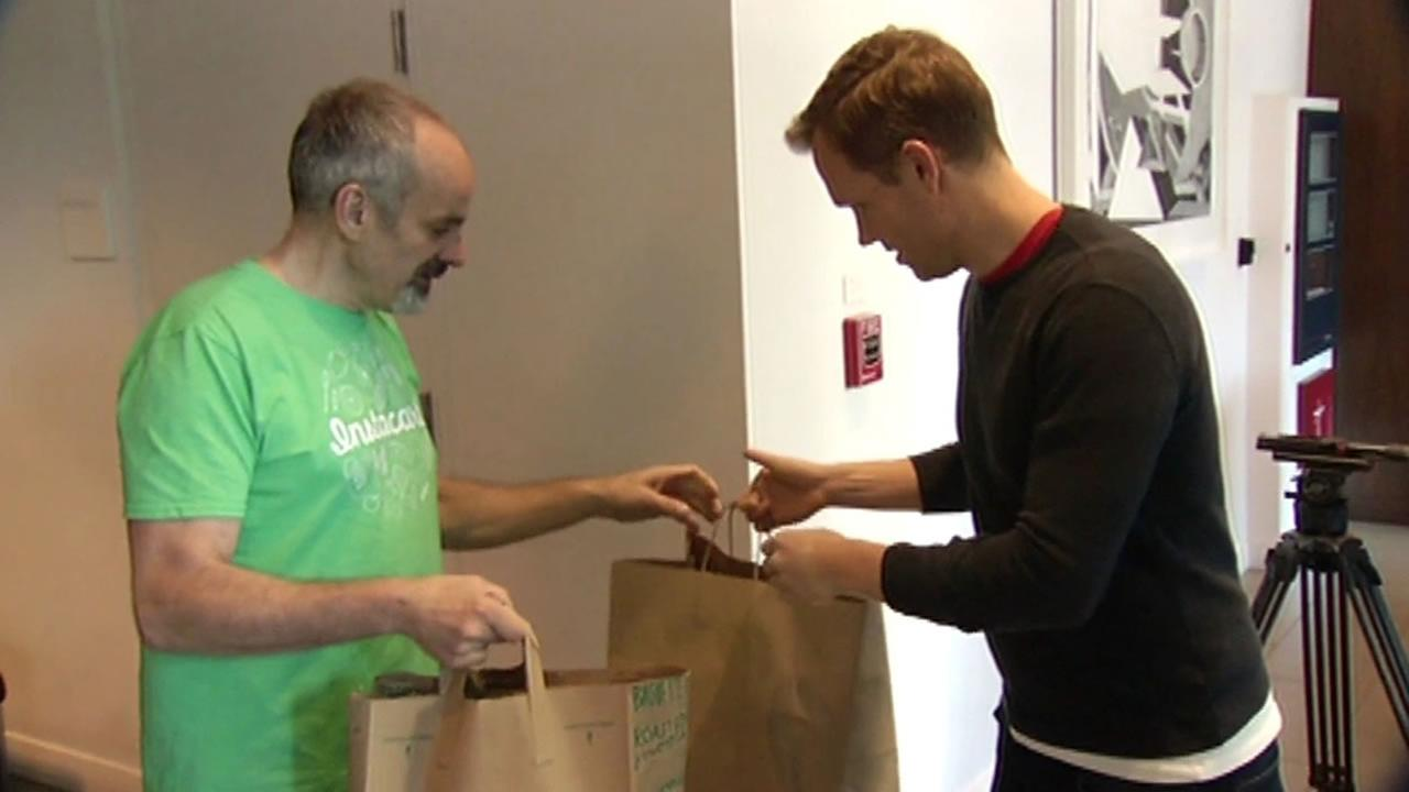 Bruce Ponte of Instacart delivers Thanksgiving groceries to a San Francisco father Nov. 26, 2015.
