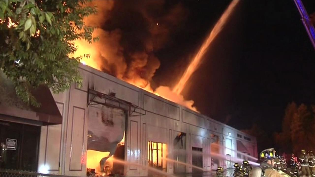Firefighters battled a two-alarm fire Nov. 27, 2015 that gutted a warehouse in Concord, Calif.