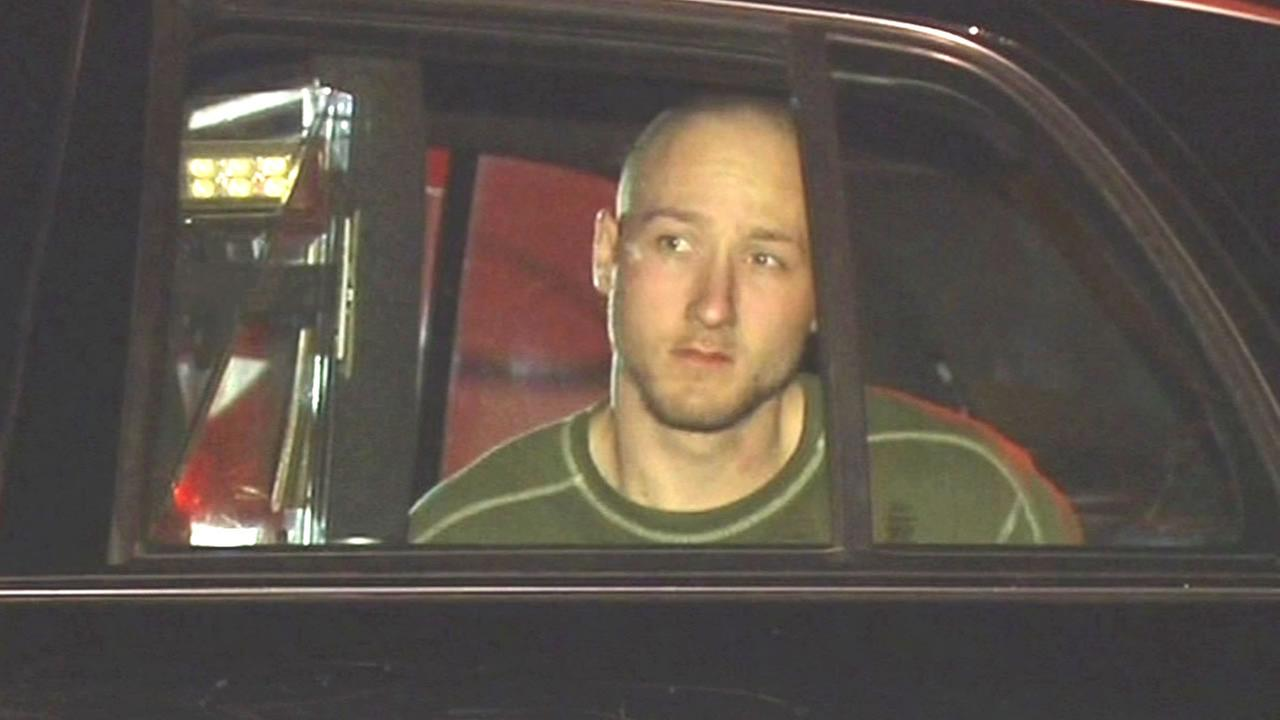 Anthony Kirincic in the back of a police car