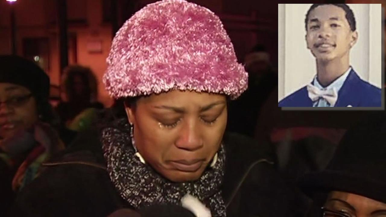 Lynette Gibson McElhaney cries at the vigil for Torian Houghs