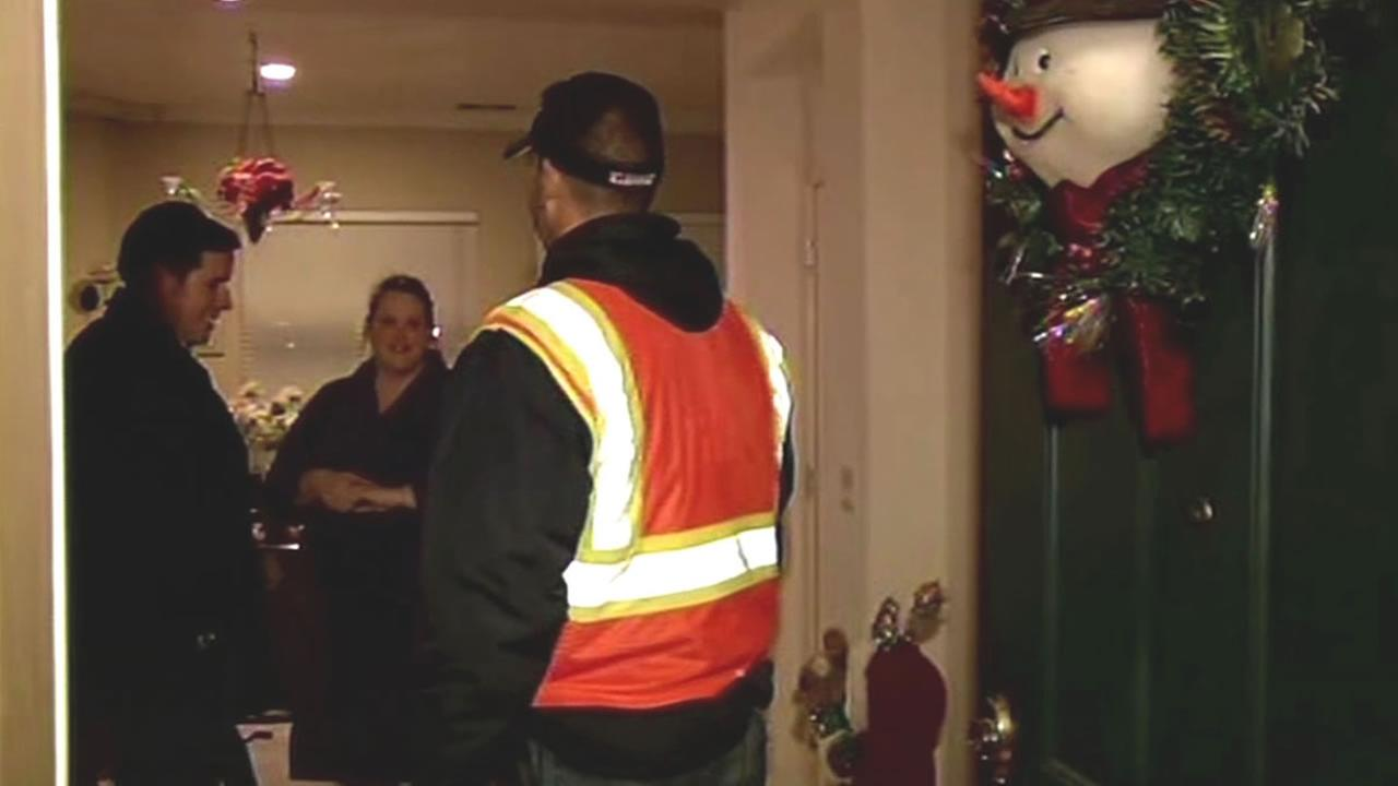 Discovery Bay resident welcomes in a PG&E worker into her home