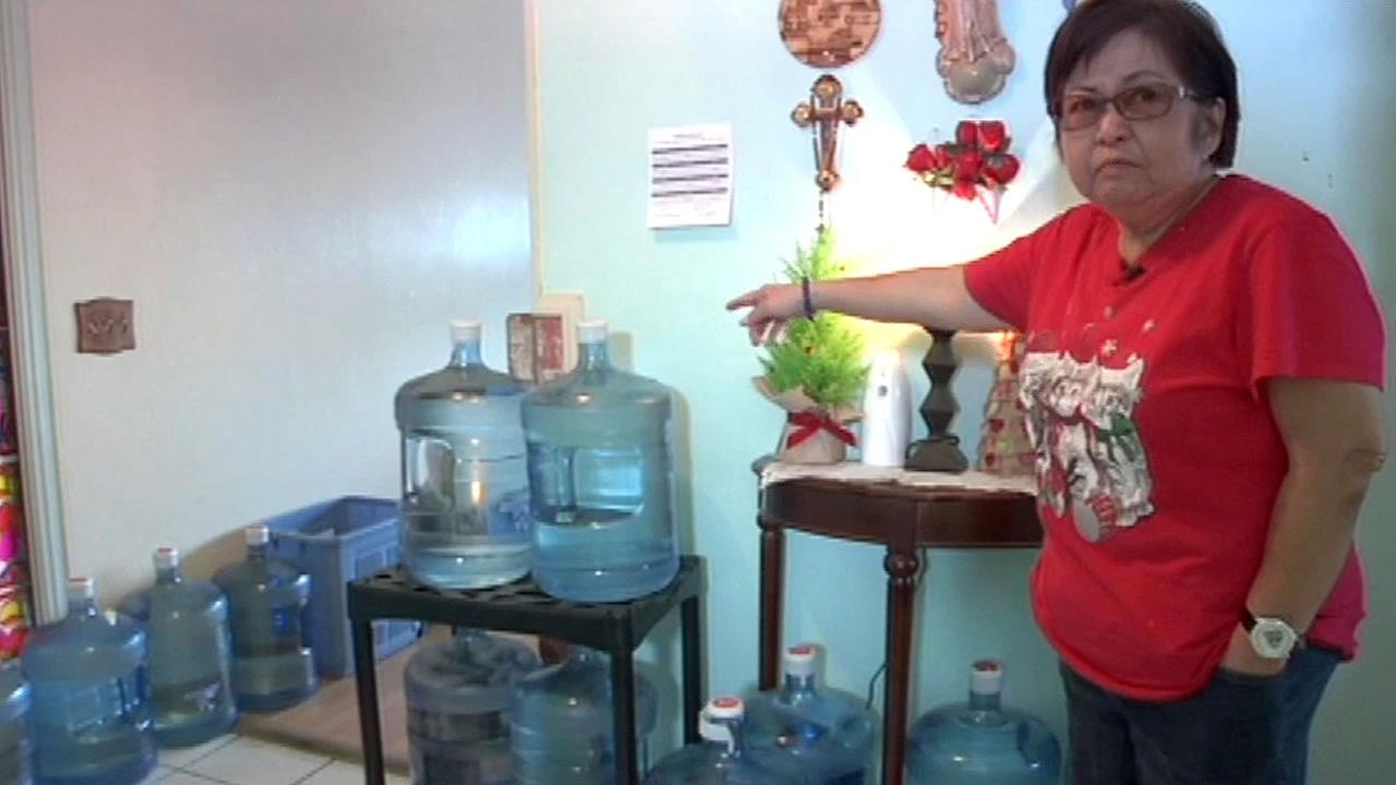 Rosita Tan stands next to Alhambra water inside her home in Daly City, Calif. in this undated image.