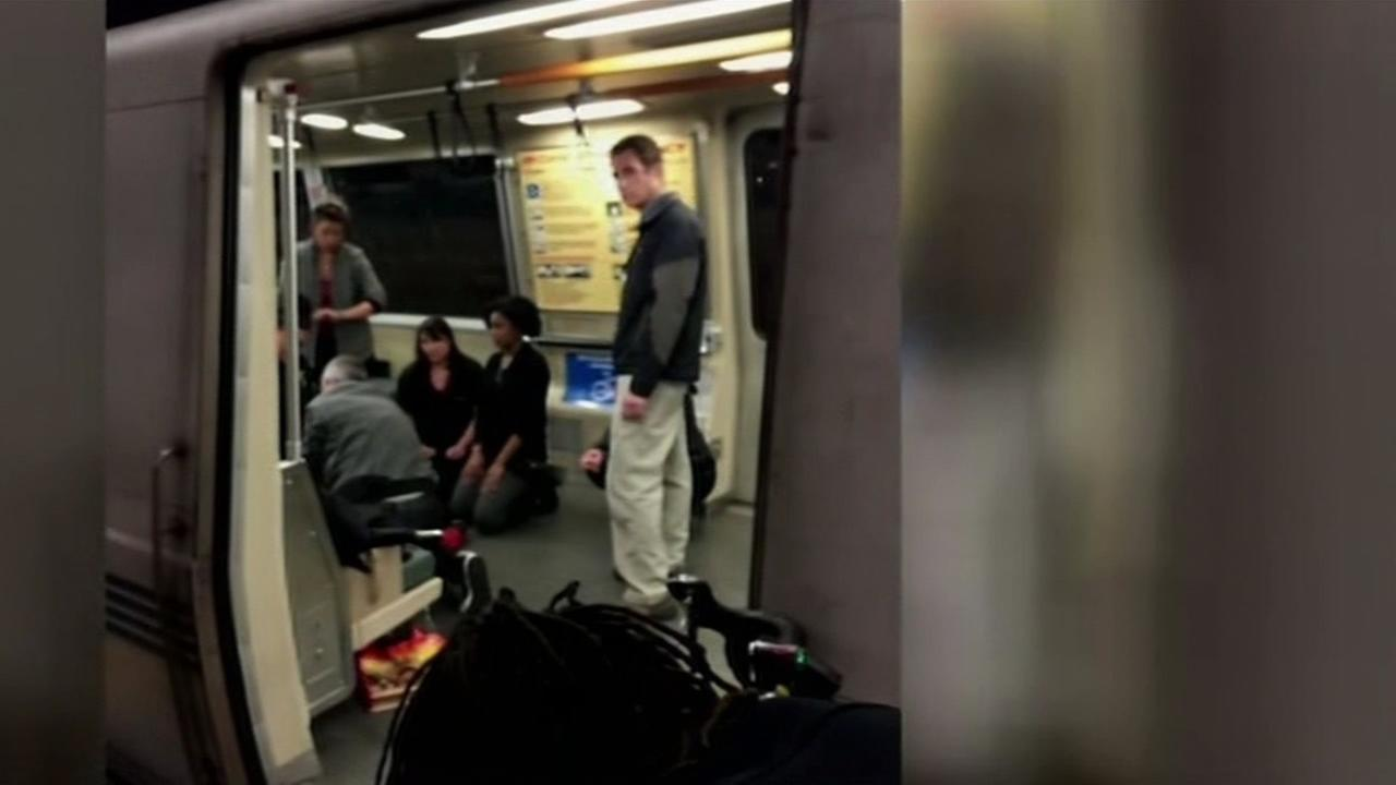 Witnesses are seen inside a BART train in West Oakland, Calif. following a fatal shooting on Saturday, January 9, 2016.