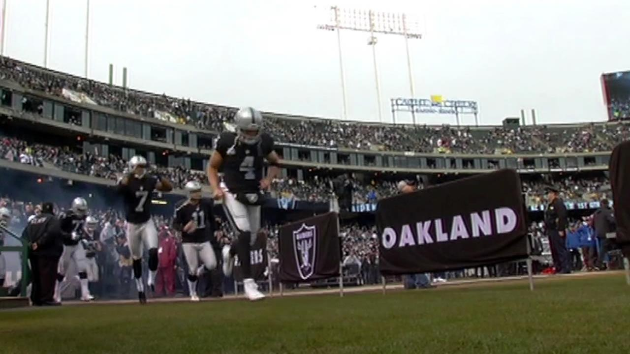 The Oakland Raiders are seen running across a field at the O.co Coliseum in Oakland, Calif. in this undated image.