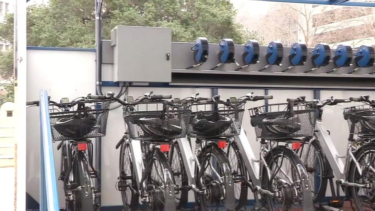 Solar-powered electric bikes at a charging station in Oakland, Calif.
