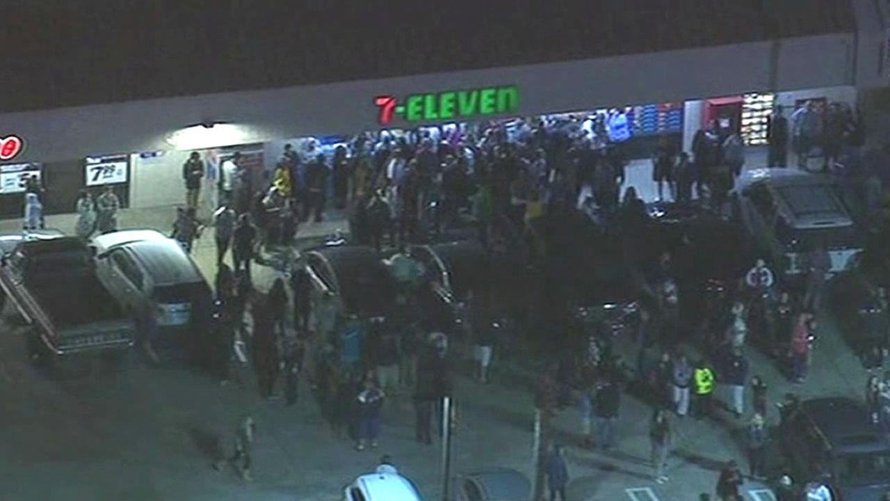 crowds gather outside 7-Eleven store that sold winning Powerball ticket