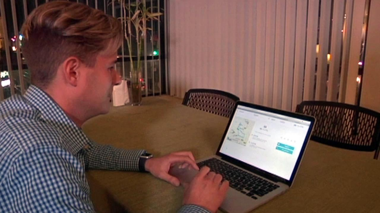 A man is seen on a computer in this undated image.